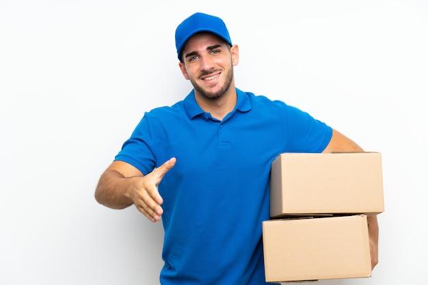 Homem entrega, sobre, isolado, branca, handshaking, após, bom negócio