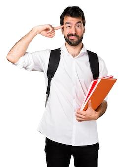 Homem estudante fazendo um gesto louco
