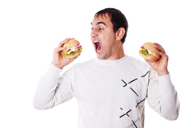 Homem faminto precisa muito de um hambúrguer