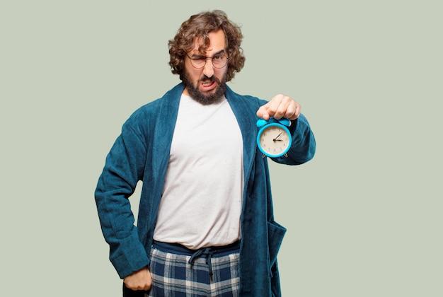 Homem jovem, desgastar, bathrobe, noite, paleto, com, um, despertador