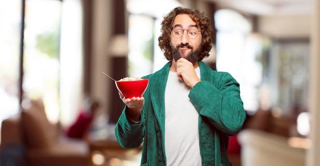 Homem jovem, desgastar, bathrobe, noturna, paleto, com, um, tigela café da manhã
