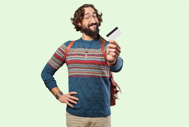Homem jovem hippie com um cartão de crédito