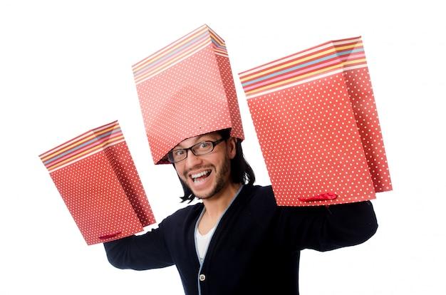 Homem jovem, segurando, sacolas plásticas, isolado, branco