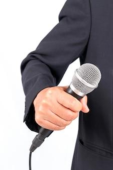 Homem negócio, segurando, um, microfone, isolado, branco, fundo