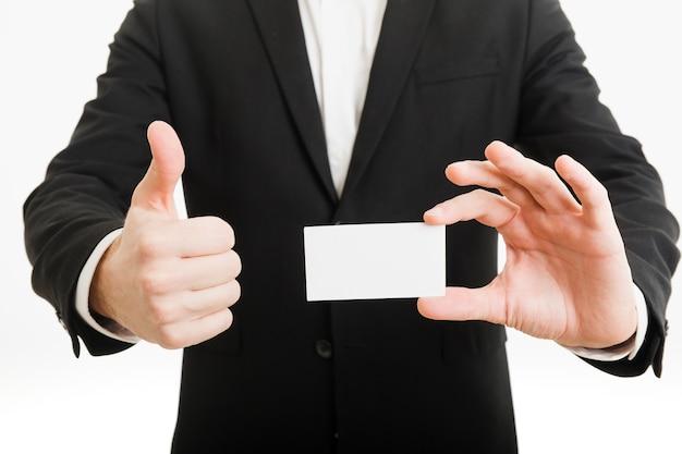 Homem negócios, apresentando, cartão negócio, e, fazendo, polegares cima, gesto