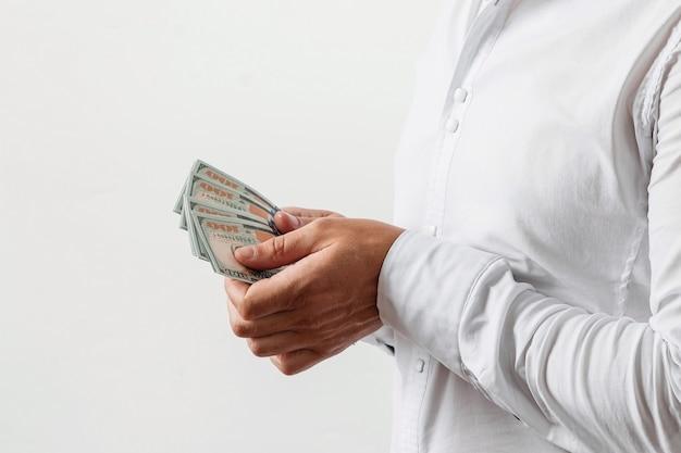 Homem negócios, contagem, dólares