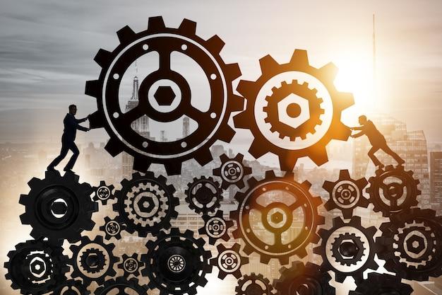 Homem negócios, em, trabalho equipe, conceito, com, cogwheels