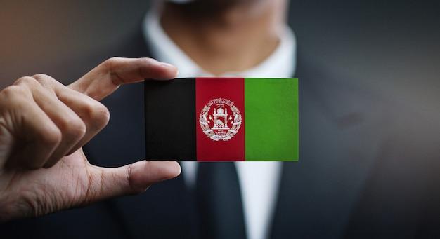 Homem negócios, segurando, cartão, de, bandeira afeganistão