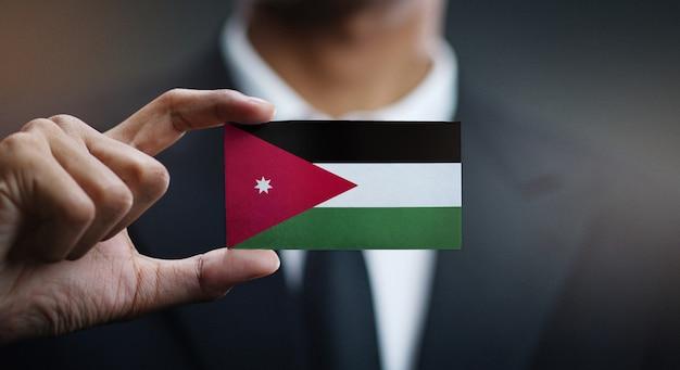 Homem negócios, segurando, cartão, de, bandeira jordânia