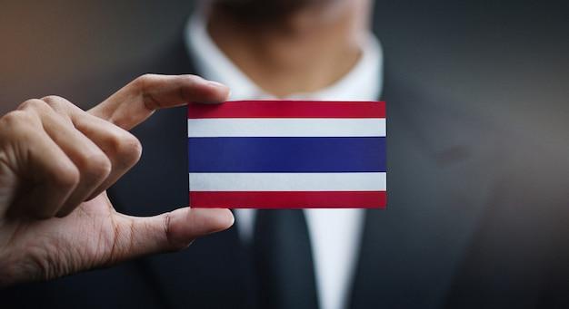 Homem negócios, segurando, cartão, de, bandeira tailandia