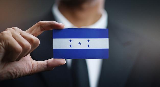 Homem negócios, segurando, cartão, de, honduras, bandeira