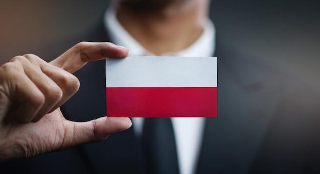 Homem negócios, segurando, cartão, polônia, bandeira