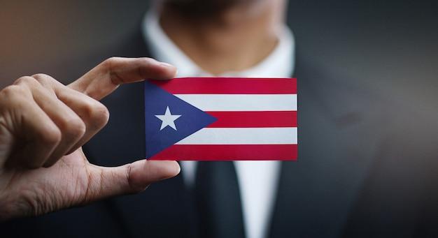 Homem negócios, segurando, cartão, puerto rico, bandeira