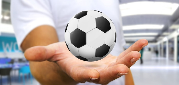 Homem negócios, segurando, futebol, em, seu, mão