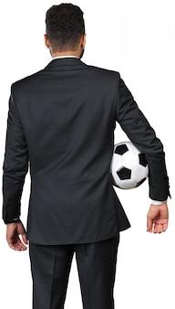 Homem negócios, segurando, um, bola futebol