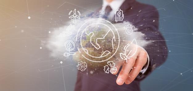 Homem negócios, segurando, um, globo mundial, surronding, por, ecologia, ícones, e, conexão, 3d, fazendo
