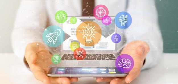 Homem negócios, segurando, um, nuvem, de, coloridos, startup, ícone, bolha, com, um, laptop, 3d, fazendo