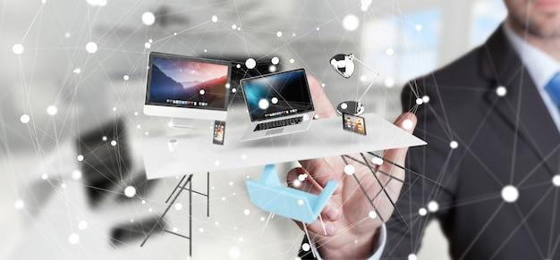 Homem negócios, tocando, voando, escrivaninha, laptop, telefone, e, tabuleta, com, seu, dedo