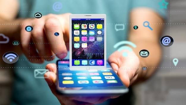 Homem negócios, usando, um, smartphone, com, um, tabuleta, cercar, por, app, e, social, ícone