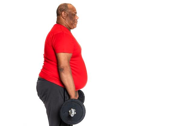 Homem negro e afro-americano gordo e obeso se exercita para perder peso