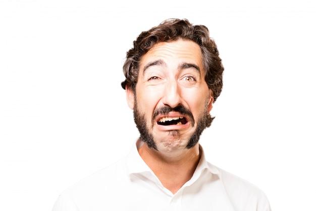 Homem que grita com a boca aberta