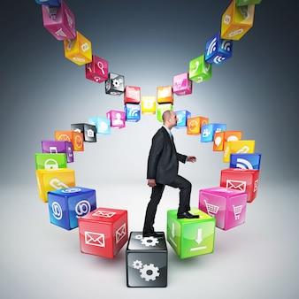 Homem sobe escala feita com cubos e ícones de cores diferentes