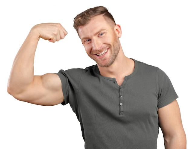 Homem sorridente, mostrando, bíceps