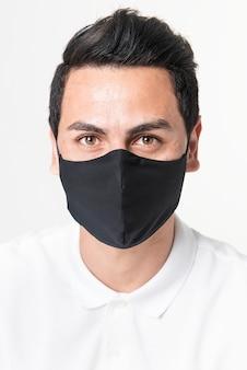 Homem usando máscara de tecido preto para campanha de proteção covid-19