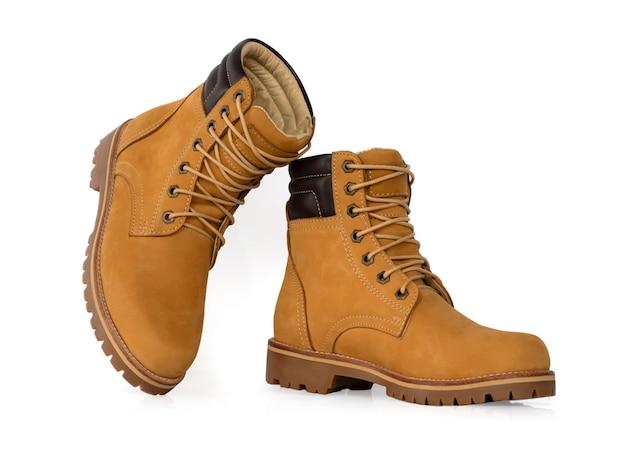 Homens moda couro amarelo botas isoladas.