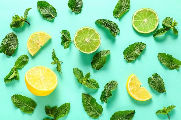 Hortelã aromática e frutas cítricas em fundo verde