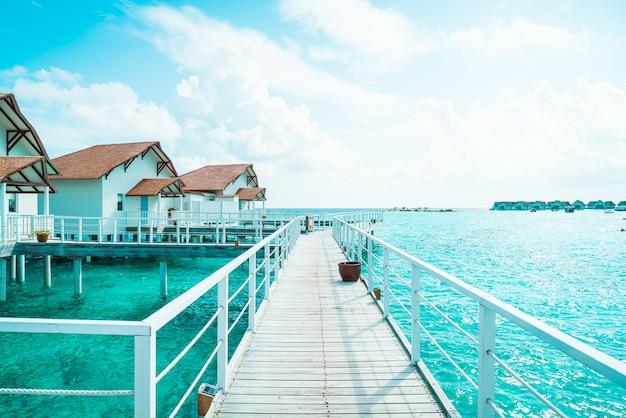Hotel tropical bonito ilha maldivas e ilha com praia e mar