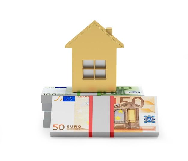 Ícone de casa dourada em maços de notas de euro