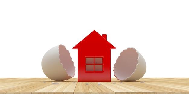 Ícone de casa eclodido de uma casca de ovo em uma madeira