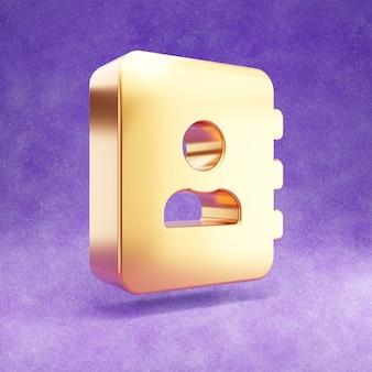 Ícone de livro de endereços dourado isolado em veludo violeta