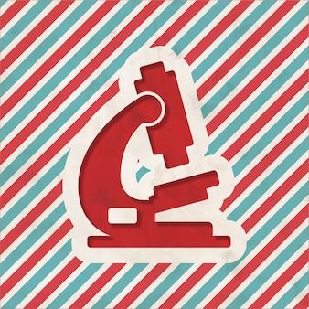 Ícone de microscópio em fundo listrado de vermelho e azul. conceito vintage em design plano.
