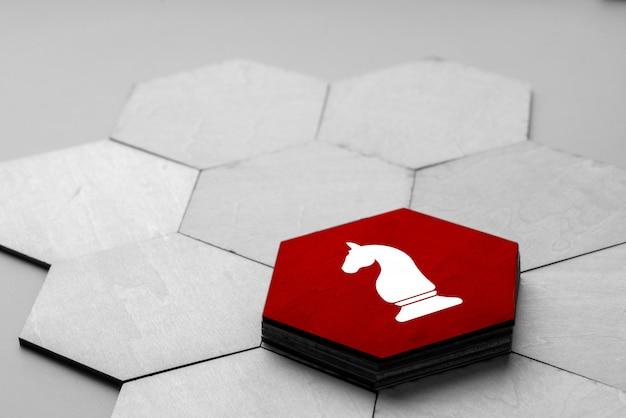 Ícone de negócios e estratégia no quebra-cabeça colorido
