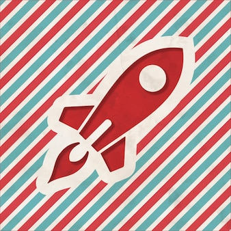 Ícone de subir foguete sobre fundo listrado de vermelho e azul. conceito vintage em design plano.