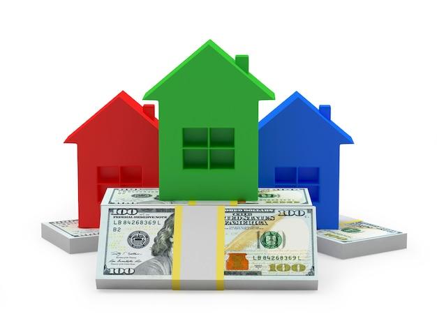 Ícones de casas coloridas em uma pilha de notas de dólar.