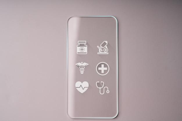 Ícones de saúde em vidro transparente