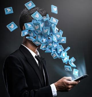 Ícones do twitter surgindo na cara de um homem