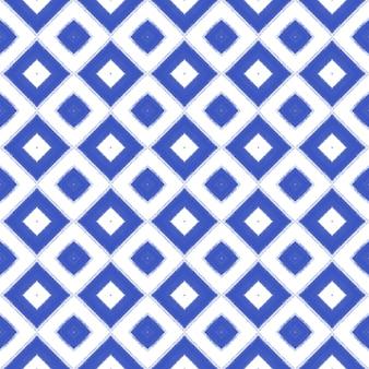 Ikat repetindo design de trajes de banho. fundo de caleidoscópio simétrico índigo. impressão criativa pronta para têxteis, tecido de biquíni, papel de parede, embrulho. padrão de trajes de banho de ikat de verão.