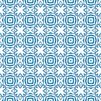 Ikat repetindo design de trajes de banho. projeto chique do verão do boho charmoso azul. têxtil pronto para negrito, tecido de biquíni, papel de parede, embalagem. aquarela ikat repetindo a borda da telha.