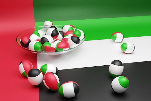 Ilustração 3d de bolas com a imagem da bandeira nacional dos emirados árabes unidos