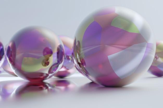Ilustração 3d de esferas de prata com formas geométricas coloridas em fundo e superfície cinza desfocados