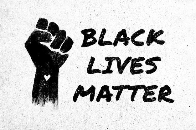 Ilustração conservada em estoque de um punho preto levantado e a frase black lives matter em um fundo branco e texturizado