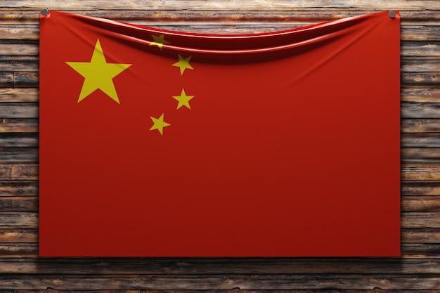 Ilustração da bandeira nacional de tecido da china pregada em uma parede de madeira