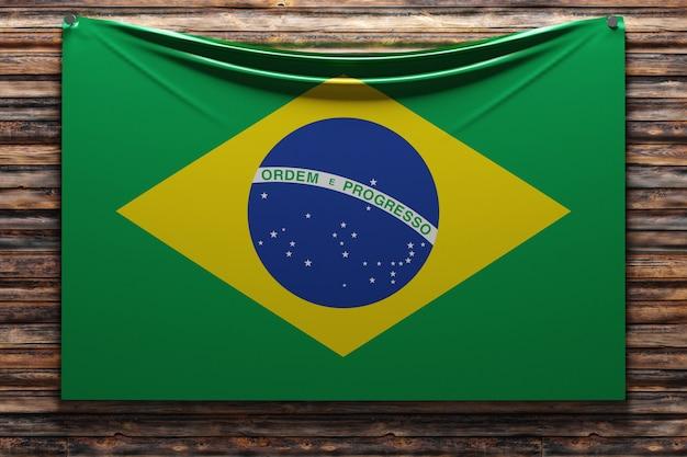Ilustração da bandeira nacional de tecido do brasil pregada na parede de madeira