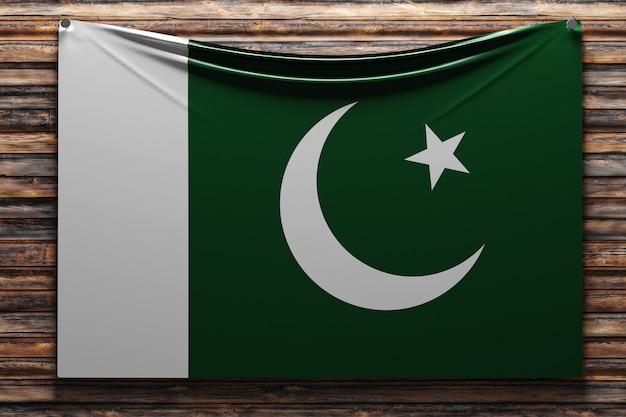 Ilustração da bandeira nacional de tecido do paquistão pregada em uma parede de madeira