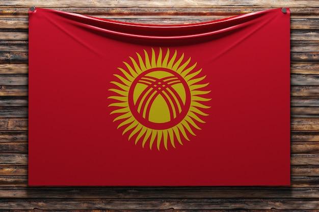 Ilustração da bandeira nacional de tecido do quirguistão pregada em uma parede de madeira