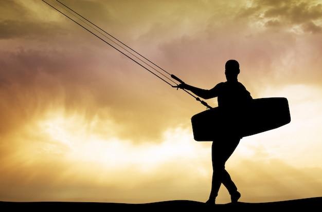 Ilustração de surfista de pipa ao pôr do sol